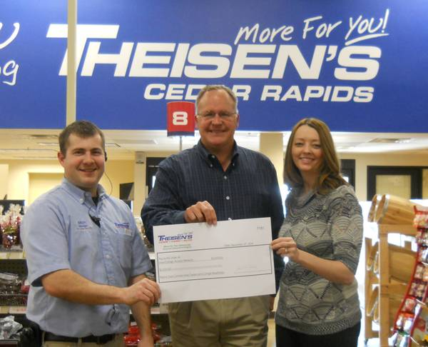 Cedar Rapids NE Theisen's Manager Mitch Klepper presents ICAN Executive Director Rob Miller and Director of Communications Brittania Morey with a grant award for college and career readiness programming in Linn County high schools.